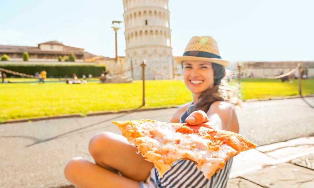 девушка с пицой в руках, via shutterstock