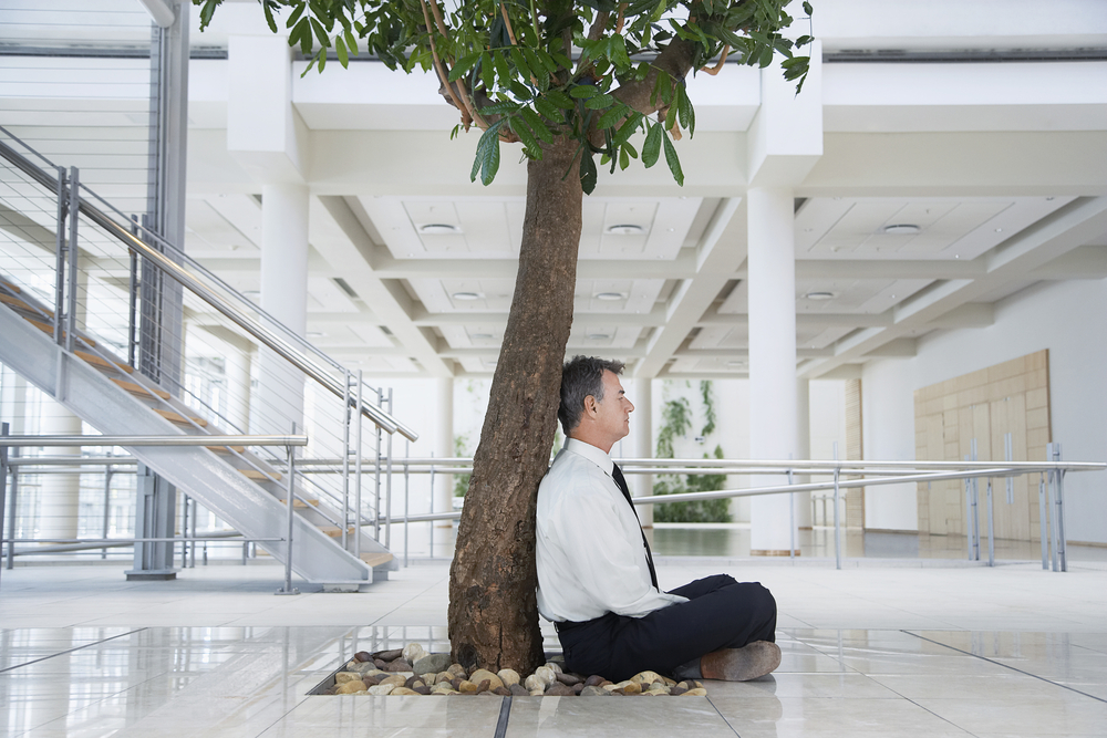 мужчина на роботе медитирует, via shutterstock