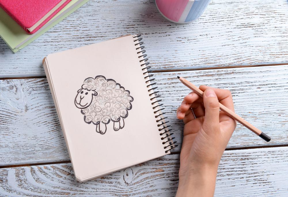 рисунок в блокноте карандашом, via shutterstock