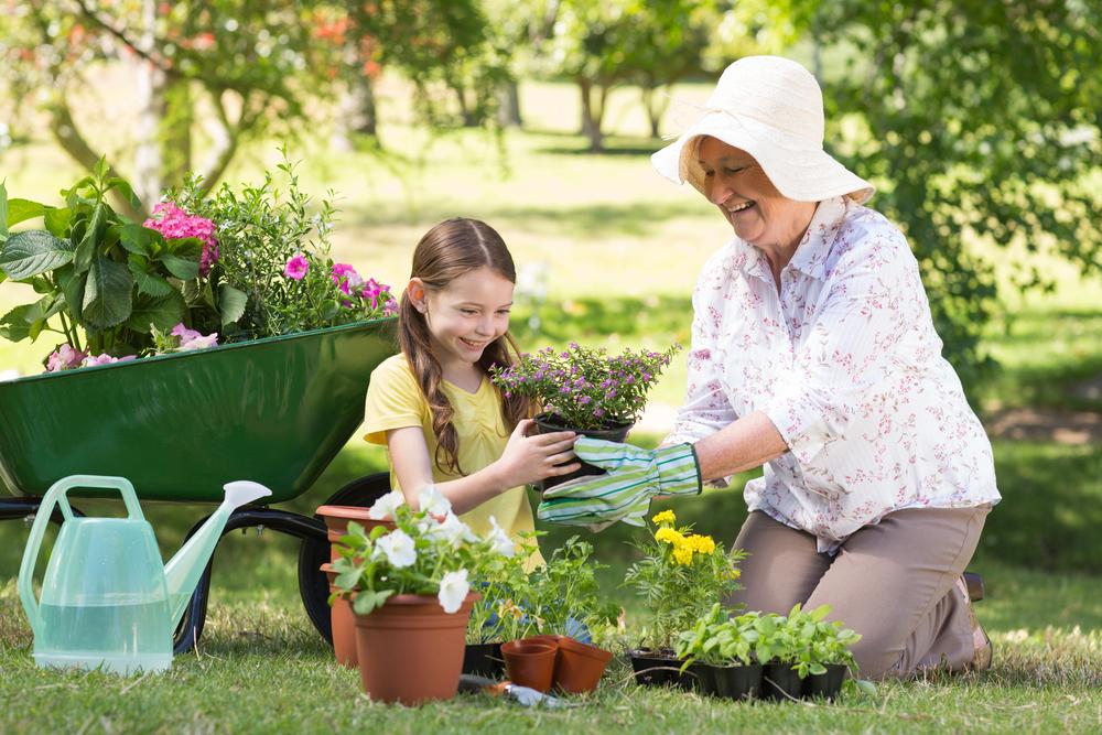 бабушка с внучкой в саду, via shutterstock