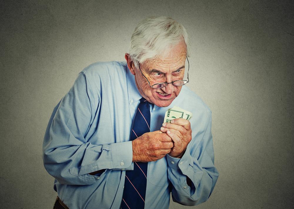 пожылой мужчина с деньгами, via shutterstock