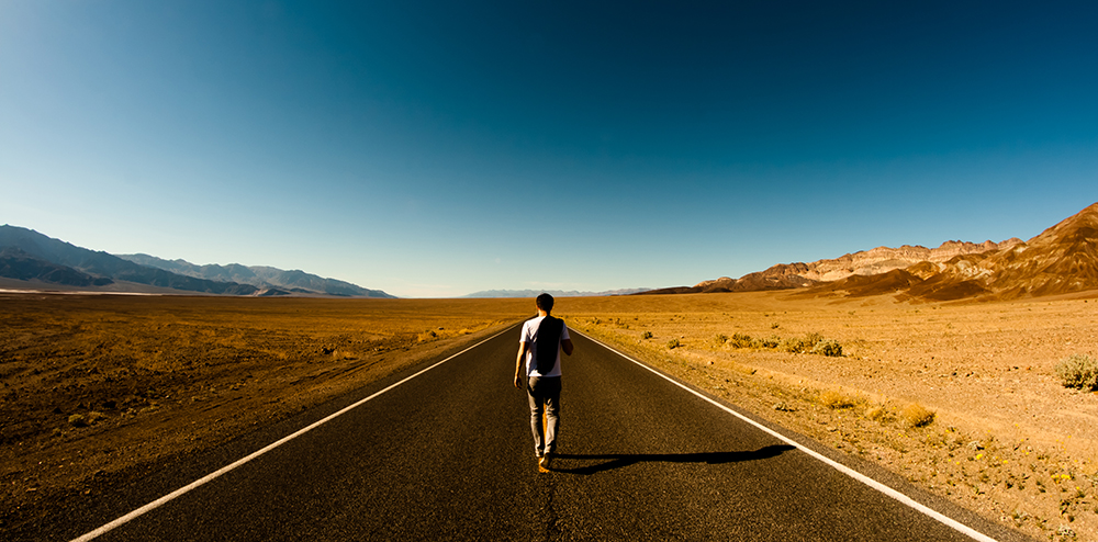 man-walks-the-road1