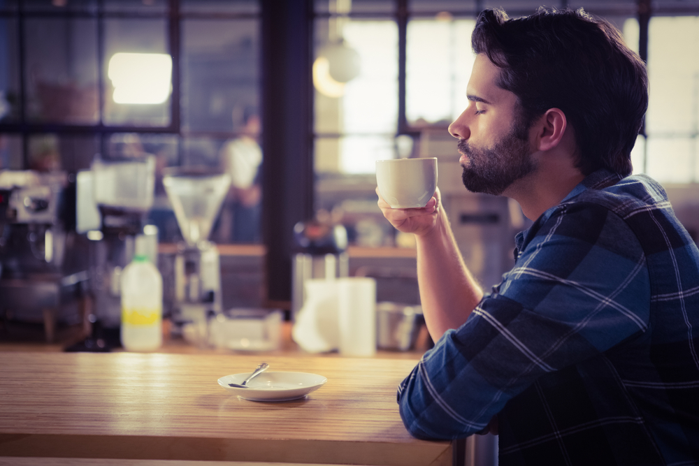 мужчина пьёт кофе, via shutterstock