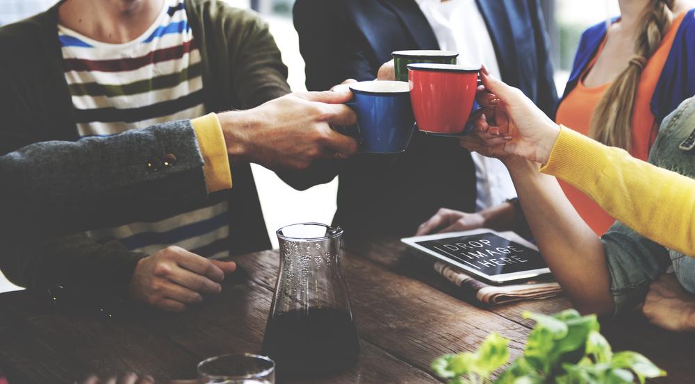 группа людей за кофе, via shutterstock