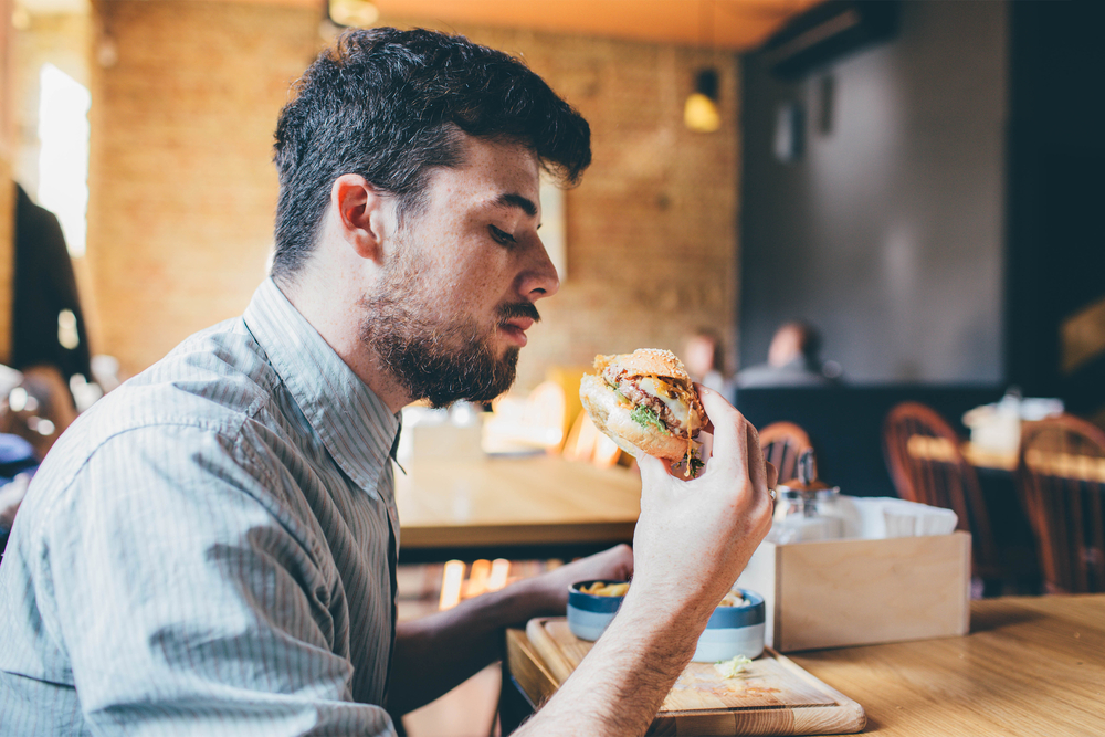 мужчина за обедом, via shutterstock